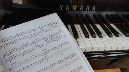 Yamaha Piano keyboard with Piano music book
